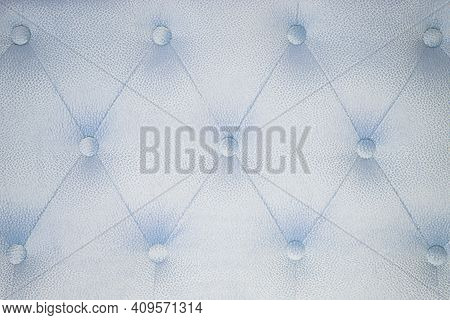 Fabric Background Of A Sofa Or Bed Close-up. Fabric Pattern. Abstract Background For Furniture. Back