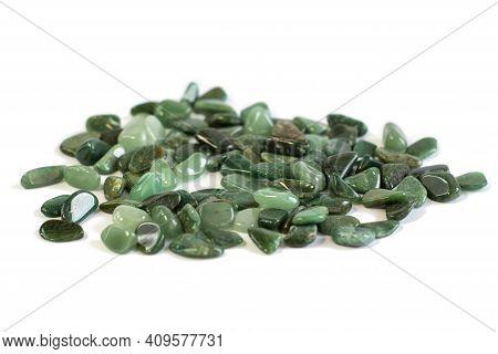 Macroshooting Of Natural Mineral Rock Specimen - Tumbled Green Aventurine Gemstone Isolated On White