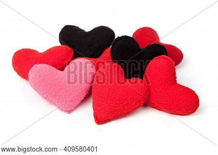 Heap Of Little Red, Pink And Black Handsewn Fleece Hearts, Isolated Over White. Handmade Valentine G