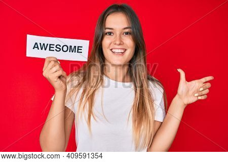 Beautiful caucasian woman holding awesome banner smiling happy pointing with hand and finger to the side