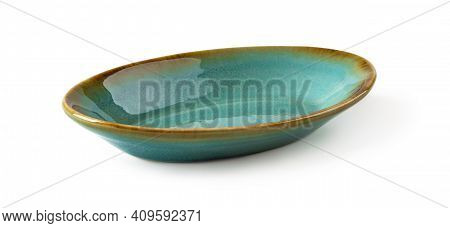 Side View Of Oblong Turquoise Ceramic Plate Isolated On A White Background. Empty Crockery For Food