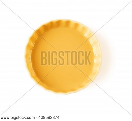 Top View Of Round Yellow Ceramic Plate With Wavy Edge Isolated On A White Background. Empty Crockery