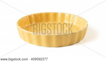 Side View Of Round Yellow Ceramic Plate With Wavy Edge Isolated On A White Background. Empty Crocker