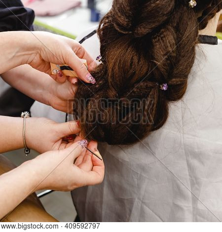 Hairstyle In Hair Training Center For Hairdresser Stylist. Hairdresser Making Hairstyle To Brown Hai