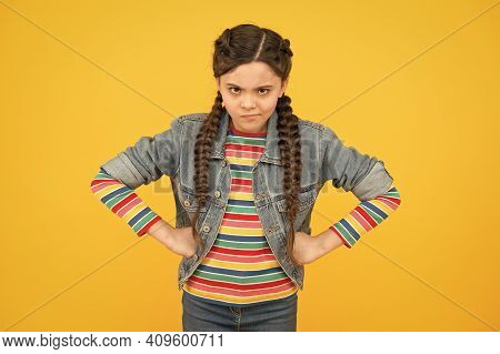In Bad Humor. Moody Little Child Yellow Background. Little Baby Wear Braided Hairstyle. Little Girl