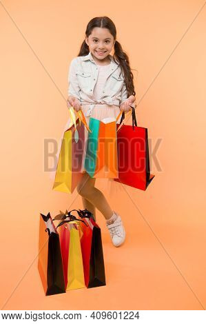 Package And Girl. Girl With Colorful Package. Shopping Package In Hand Of Girl. Girl With Package Ba