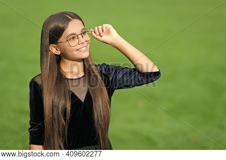 Eyewear To Help You See Better. Happy Kid Wear Glasses Green Grass. Fashion Eyewear. Vision Correcti