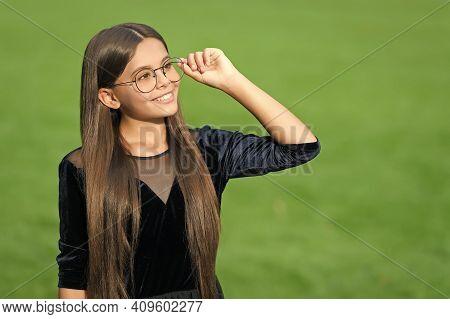 Eyewear To Help You See Better. Happy Kid Wear Glasses Green Grass. Fashion Eyewear. Vision Correcti