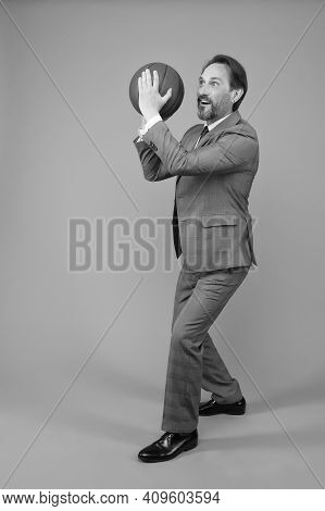 Businessman Warm Up With Basketball In Office, Prepare To Throw Concept.