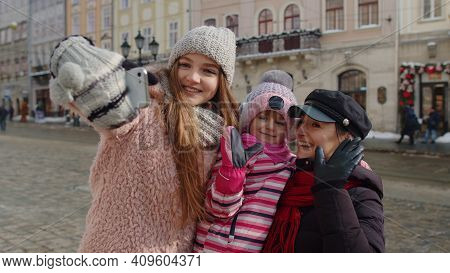 Sisters Couple Taking Selfie, Posing, Making Video Conferencing On Mobile Phone Together With Younge
