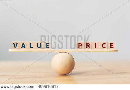 Wooden Seesaw Scale Empty On Wooden Sphere On Wood Table With Wording Value And Price Balancing