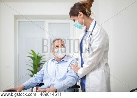 Patient talking to a doctor nurse, covid coronavirus healthcare concept
