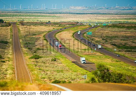 Classic View Of Highway Road Running Through The Barren Scenery Of The American Southwest With Extre