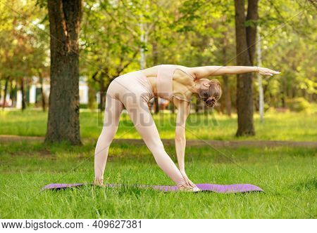Young Attractive Female Practicing Exercises. Early Morning Yoga. Finding My Balance. Sport And Recr
