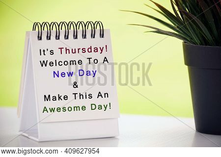 Inspirational Quote On White Paper Stand With Potted Plant And Blurred Background - It Is Thursday,