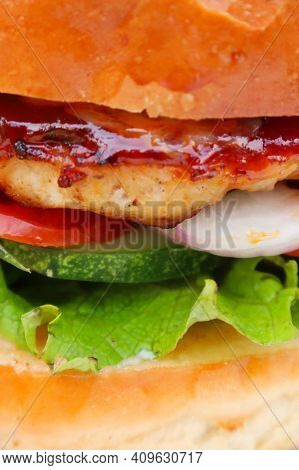 Street Food Burger. Delicious Burger With Sauce, Cheese, Bacon, Vegetables, Salad And Tomatoes On A