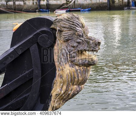 Decorative Figure Of A Lion On The Prow Of An Ancient Sailboat At Bermeo In The Basque Country In Sp