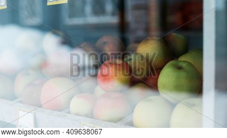 Red, Green Apples On A Shop Window. Selective Focus