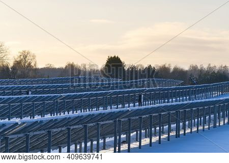 Solar Panel Back Side Field Covered With Snow. Renewable Energy In Winter Low Efficiency. Renewable