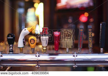 Calgary, Alberta, Canada. Several Beer Brands Taps On A Bar