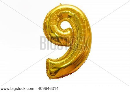 9 Made Of Gold Balloons Isolated On White Background. English 9 From Gold Balloons Isolated On White