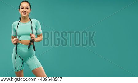 Website Header Of Sporty Young Woman With Skipping Rope Posing In Studio