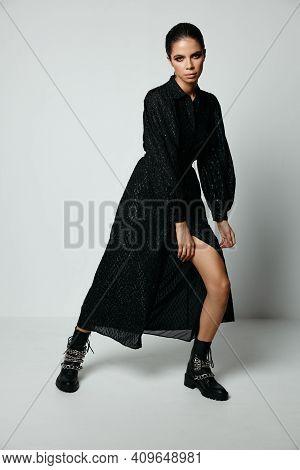 Attractive Brunette In Black Dress Posing Moda Studio