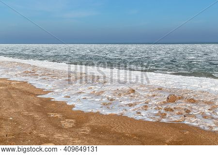 This Is Frozen Azov With Ice Floes Near The Coast And An Frozen Surf On A Sandy Beach.