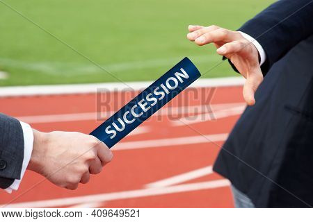 Succession - Businessman Hands Over Baton In Stadium At Relay Race