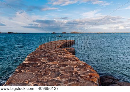 Scenic View Of Stone Pier In The Waterfront Of Roscoff