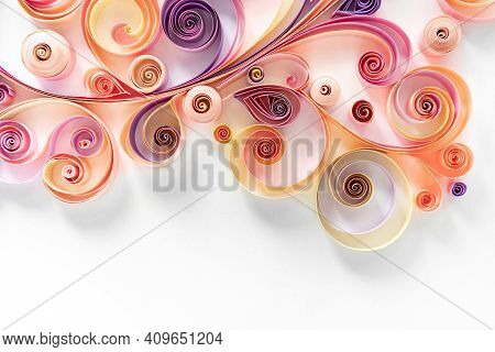 Filigree Paper Background. Quilling Paper Flower Patterns From Strips Of Twisted Colored Paper For A