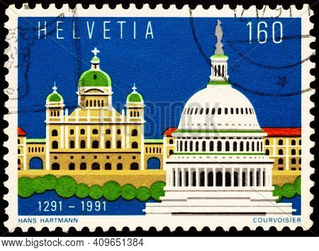 Moscow, Russia - February 23, 2021: Stamp Printed In Switzerland Shows Federal Parliament Building I
