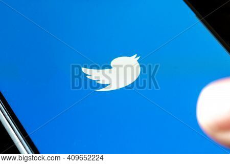 Vilnius, Lithuania - February 24 2021: Twitter App Displayed On The Smartphone With Finger. Twitter