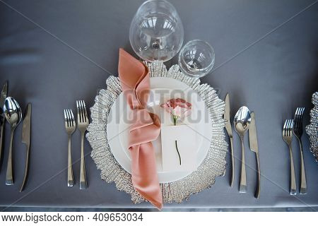 Beautifully Decorated Table With Plates, Cutlery And Glasses