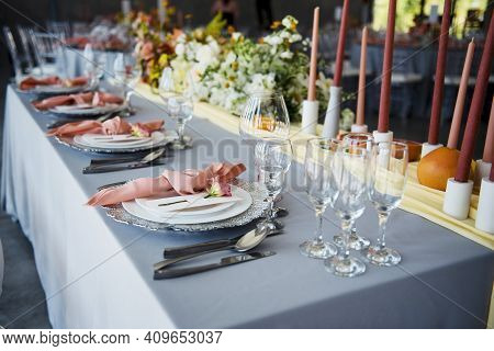 Beautiful Serving On Table With Plates, Cutlery And Glasses