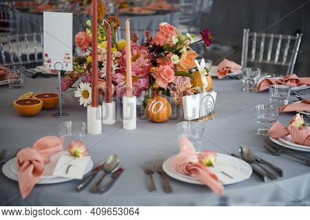 Wedding Banquet Table With Glassware, Flowers And Candles