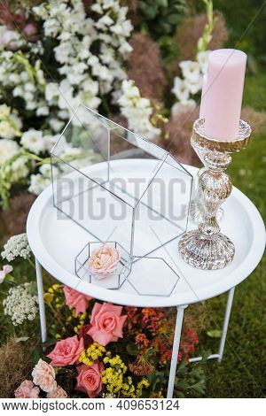 Glass Box For Wedding Cards And Presents On Table Outdoors