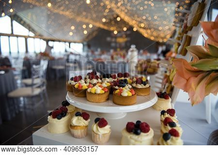Beautiful Wedding Candy Bar With Delicious Cupcakes