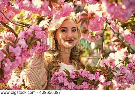 Pink Flowers Surrounding Her. Diving Into Sakura Bloom. Sakura Flowers. Flower Extract. Essential Oi