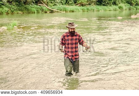 Think About Hobby. Bearded Fisher In Water. Mature Man Fly Fishing. Man Catching Fish. Fisherman Sho