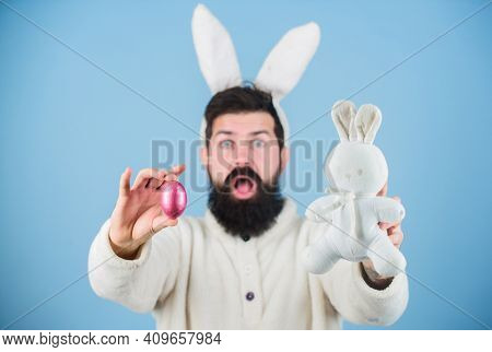 Funny Bunny With Beard And Mustache Hold Pink Egg. Easter Symbol Concept. Bearded Man Wear Bunny Ear