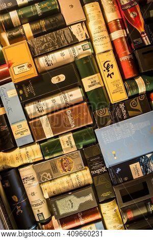 Many Whisky Bottle Packaging Arranged On A Wall