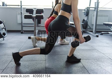 Two Active Young Women In Sportswear Warming Up Before Training At Modern Gym. Healthy Best Friends