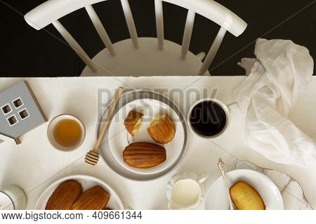 Table Top Of Breakfast Table And Chair. Madeleine Cakes, French Pastry. Dessert.