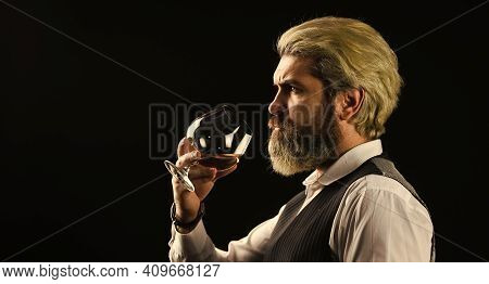 Wine Bar Or Winery. Wine Degustation. Bearded Businessman In Elegant Suit With Glass Of Wine. Sommel