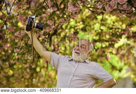 Self Portrait. Memories In Snap. Everyone Photogenic. Senior Man Taking Selfie Photo Vintage Camera.