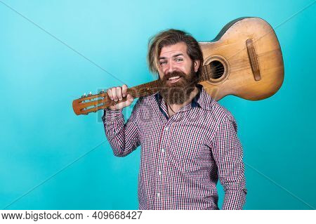 Casual Styled Guitarist. Modern Looking Bearded Hipster With Acoustic Guitar. Music Concept. Brutal