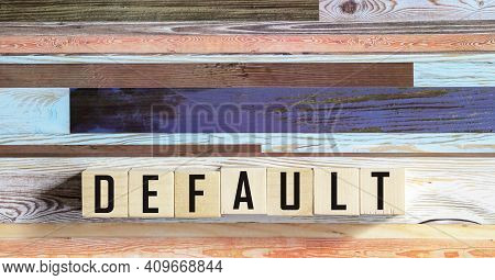 The Word Default On Wooden Cubes. Non-fulfillment, Non-fulfillment, Non-payment, Non-payment Of Debt