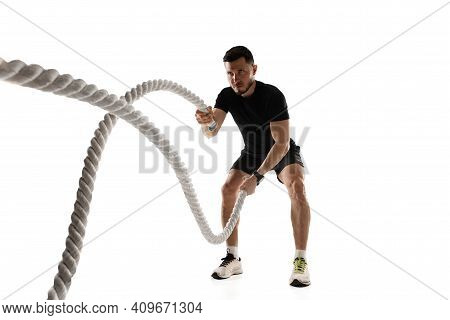 Ropes. Caucasian Professional Sportsman Training Isolated On White Studio Background. Muscular, Spor