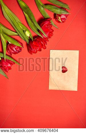 Valentines Day Background With Hearts And Red Tulips. Bouquet Of Red Tulips. Concept For Valentine's